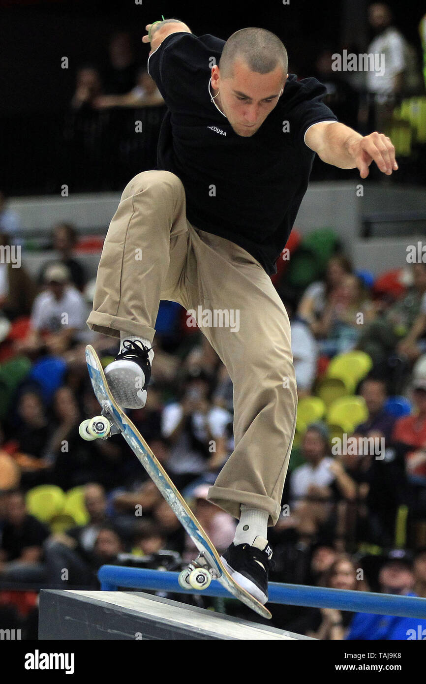 A male skater pulls a grind during the men's quarter finals