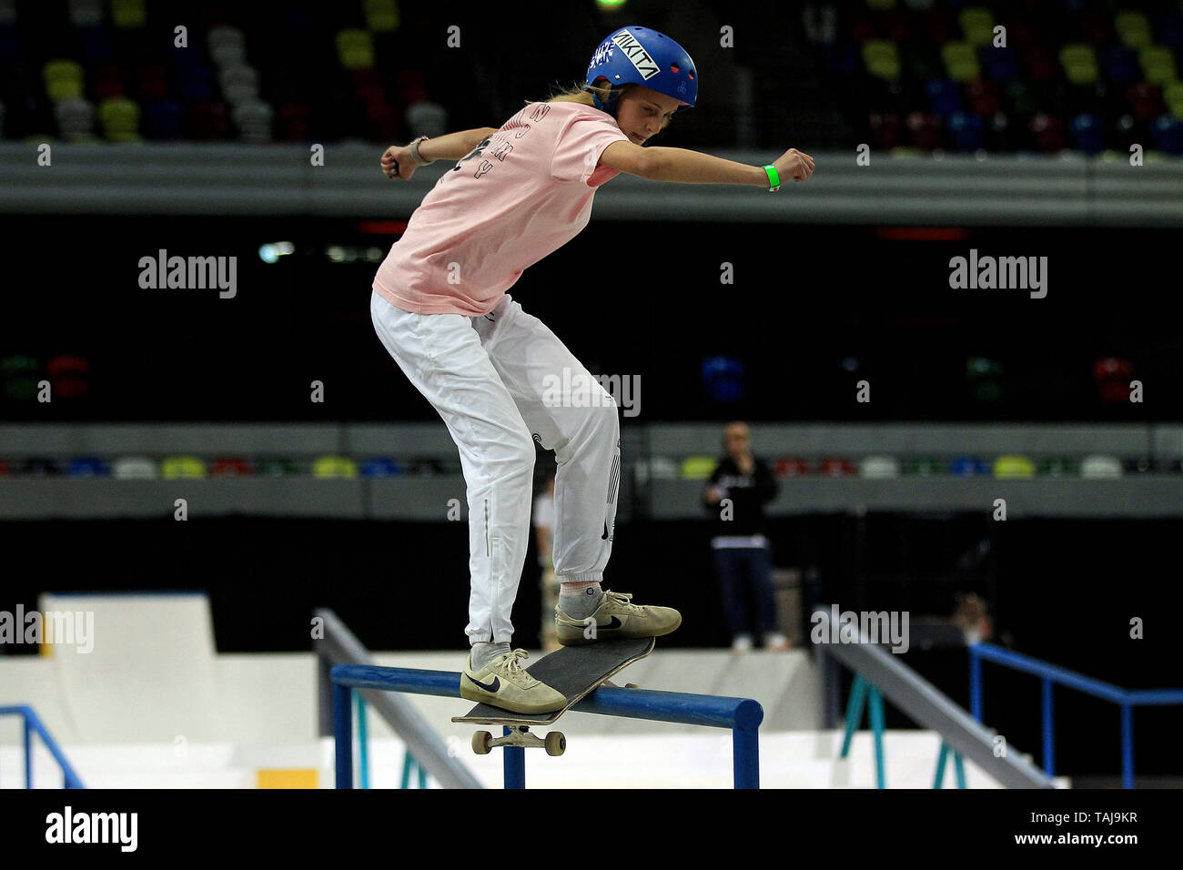 A female skater pulls a grind during the men's quarter