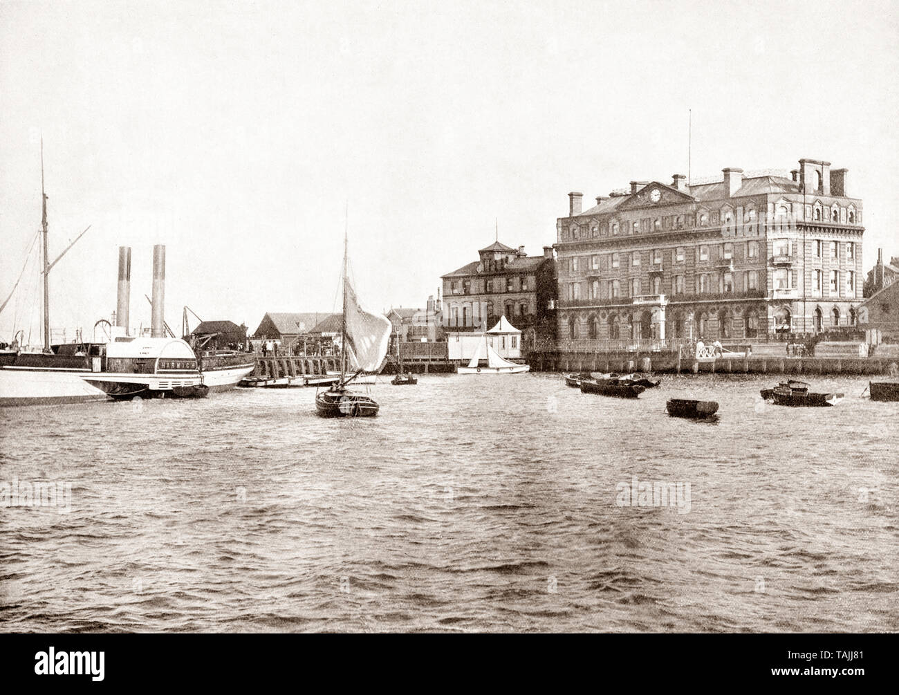 A late 19th Century view of the 'Harwich' paddle steamer quay and Great Western Hotel in Harwich, a town in Essex, England and one of the Haven ports, located on the coast with the North Sea to the east. Its position on the estuaries of the Stour and Orwell rivers and its usefulness to mariners as the only safe anchorage between the Thames and the Humber led to a long period of maritime significance, both civil and military. - Stock Image