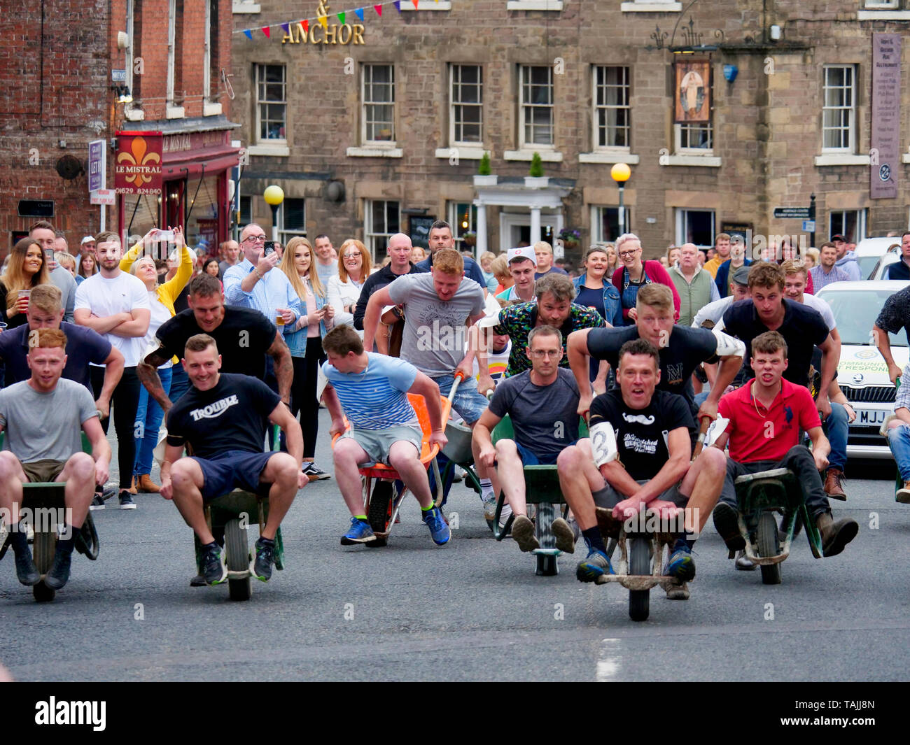 News UK: Wirksworth wheelbarrow race, 25th May 2019  Derbyshire Dales, Peak District, Derbyshire, England, UK Stock Photo