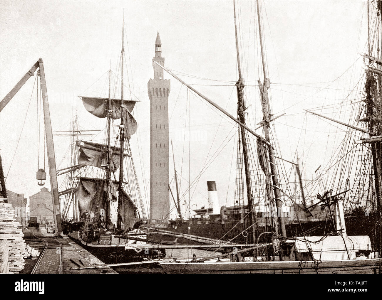 A late 19th Century view of  the Hydraulic Dock Tower  behind shipping in Grimsby, also Great Grimsby, a large coastal English seaport and administrative centre in North East Lincolnshire, on the South Bank of the Humber Estuary, close to where it reaches the North Sea. Many docks were completed in the mid-19th century with the arrival of the railway in 1848, after which it boasted the largest fishing fleet in the world by the mid-20th century, until fishing declined. - Stock Image