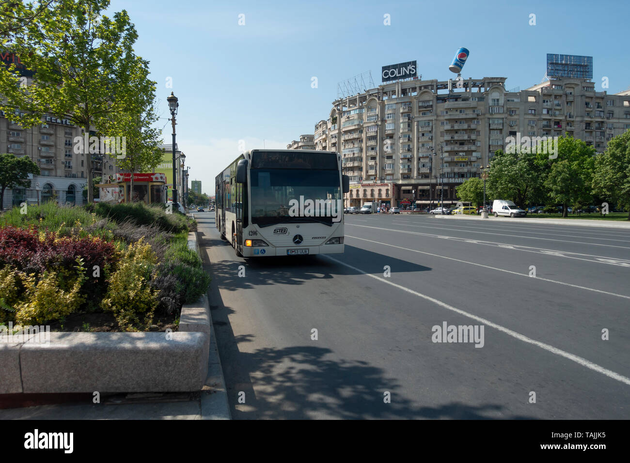 Single decker public STB bus on the south-east corner of Piața Unirii (Union Square / Unification Square)  in central Bucharest/ București,  Romania Stock Photo