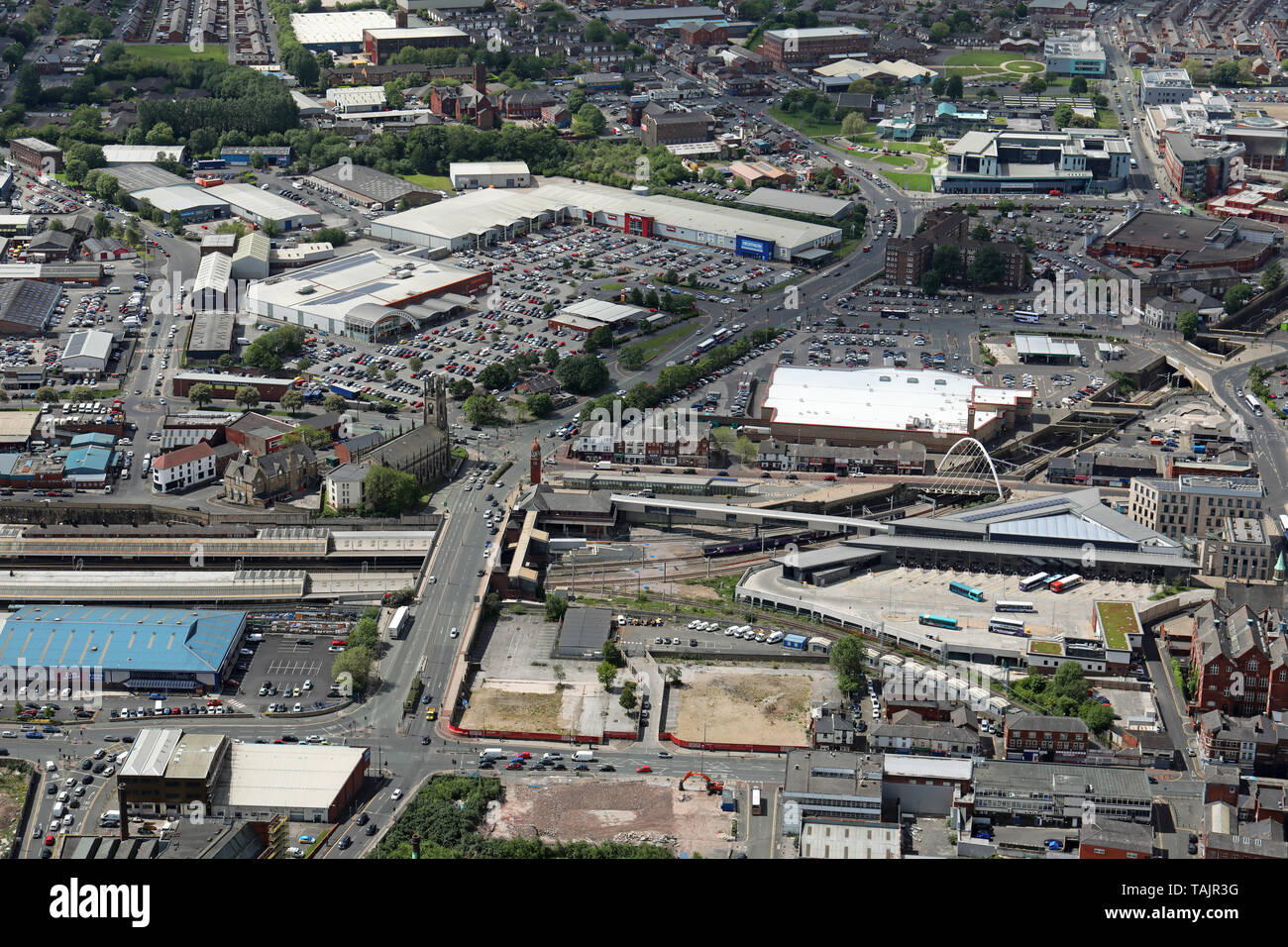 aerial view of Bolton town centre looking west down the A579 between the railway & bus stations towards Bolton Shopping Park in the distance - Stock Image