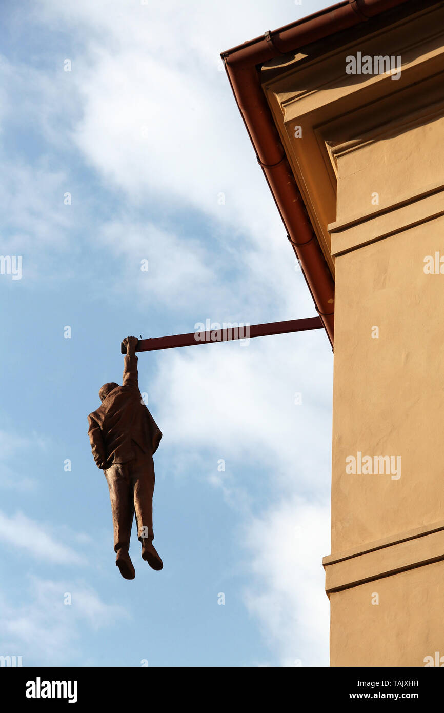 Man Hanging Out by David Cerny in Prague - Stock Image