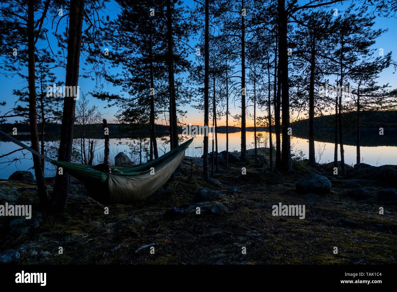 Hammock camping in Kolovesi national park, Enonkoski, Finland - Stock Image