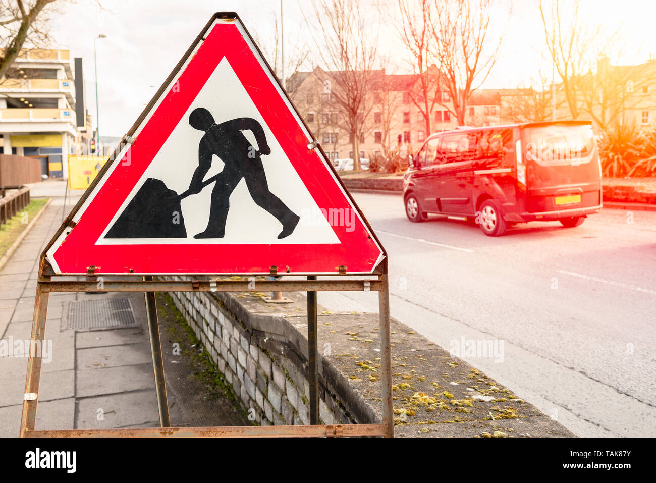 Men at work road sign at the beginning of a construction site along a street in a city centre - Stock Image