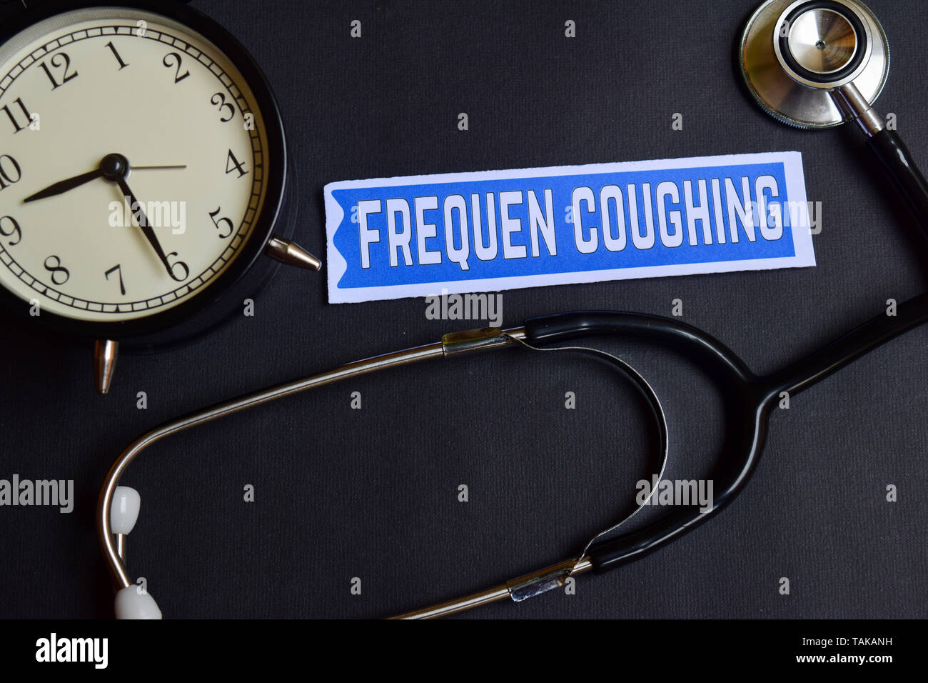 Frequen Coughing on the paper with Healthcare Concept Inspiration. alarm clock, Black stethoscope. - Stock Image