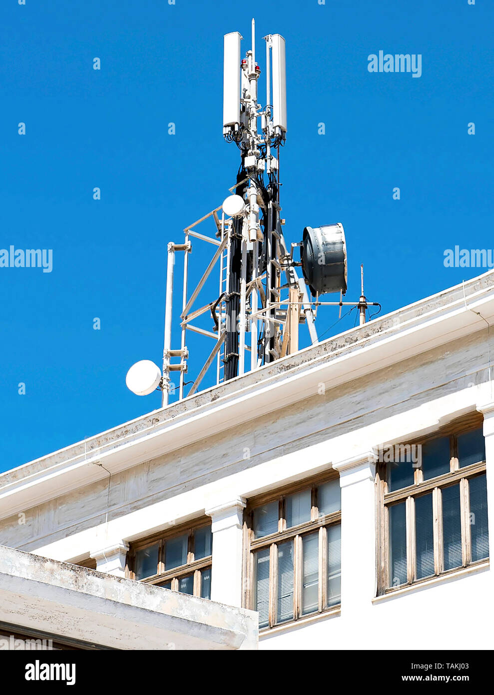 Cell phone telecommunications antennas and repeaters on building