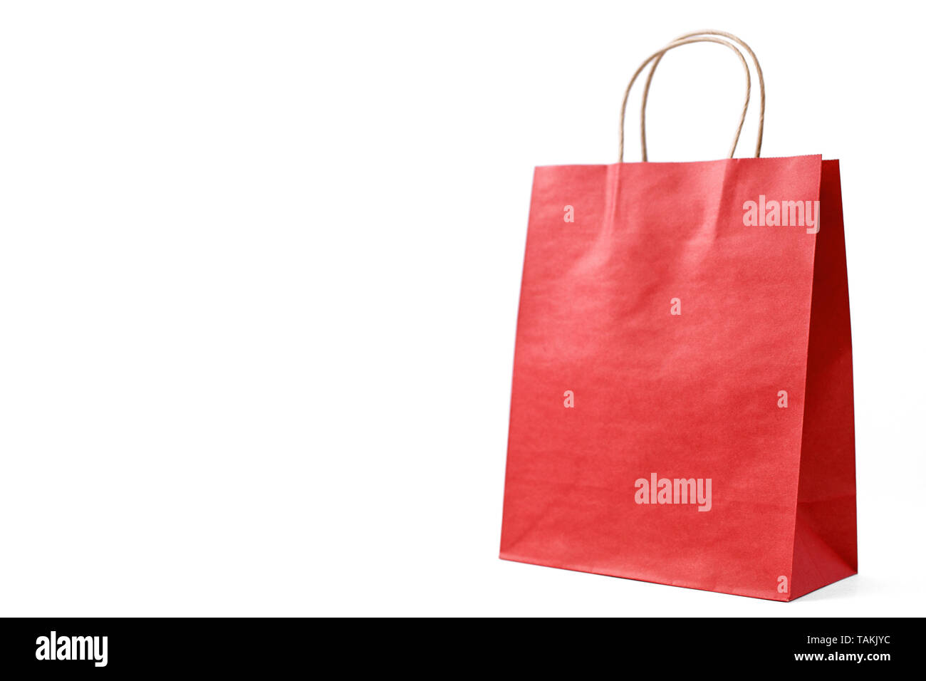 environmentally friendly cardboard red bags on white isolated background - Stock Image