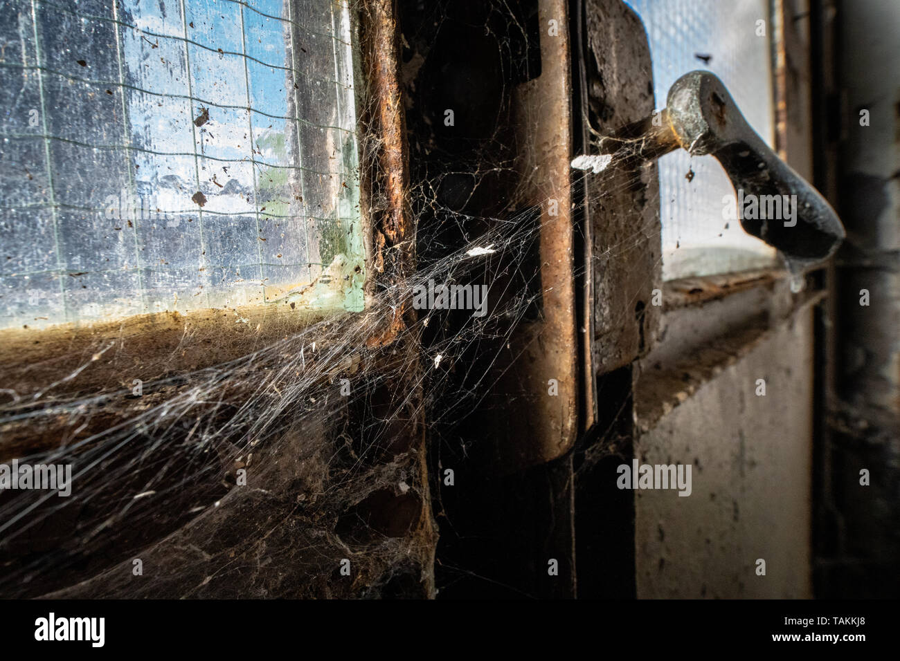 Derelict industrial abandoned old factory with rusty and weathered parts. - Stock Image