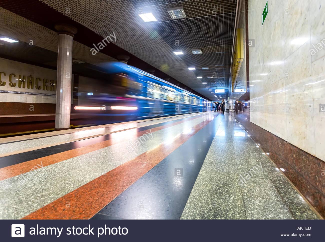 Samara, Russia - May 26, 2019: Blue subway train in motion at the subway station Rossiyskaya - Stock Image