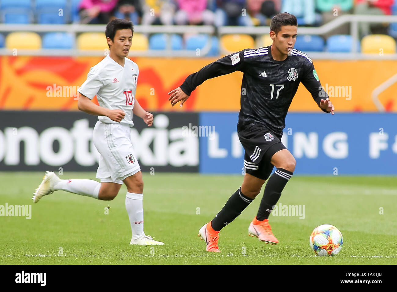 Gdynia Stadium, Gdynia, Poland - 26th May, 2019: Daniel Lopez (R) from Mexico and Mitsuki Saito (L) from Japan  are seen in action during FIFA U-20 World Cup match between Mexico and Japan (GROUP B) in Gdynia. (Final score; Mexico 0:3 Japan) - Stock Image