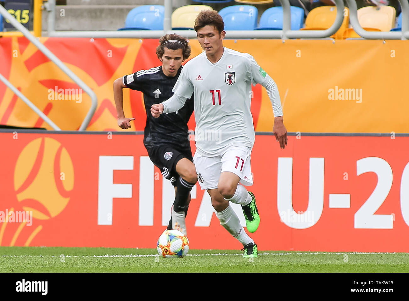 Gdynia Stadium, Gdynia, Poland - 26th May, 2019: Antonio Figueroa from Mexico and Kyosuke Tagawa from Japan are seen in action during FIFA U-20 World Cup match between Mexico and Japan (GROUP B) in Gdynia. (Final score; Mexico 0:3 Japan) - Stock Image