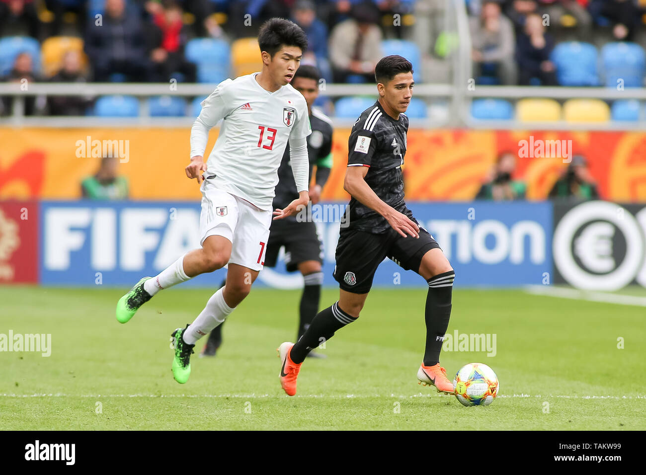 Gdynia Stadium, Gdynia, Poland - 26th May, 2019: Taisei Miyashiro(L) from Japan and Kevin Alvarez (R) from Mexico are seen in action during FIFA U-20 World Cup match between Mexico and Japan (GROUP B) in Gdynia. (Final score; Mexico 0:3 Japan) - Stock Image