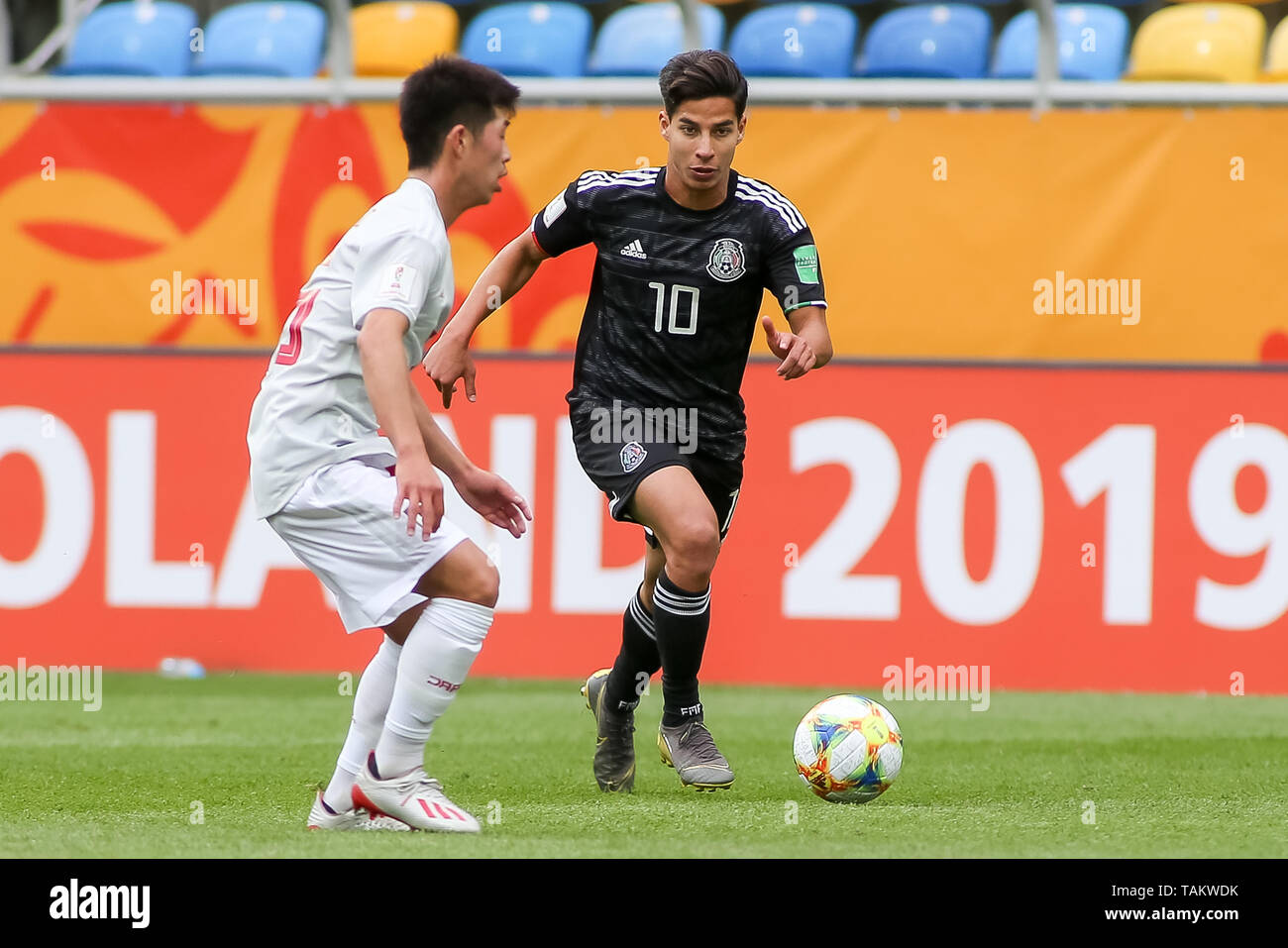 Gdynia Stadium, Gdynia, Poland - 26th May, 2019: Toichi Suzuki (L) from Japan and Diego Lainez (R) from Mexico are seen in action during FIFA U-20 World Cup match between Mexico and Japan (GROUP B) in Gdynia. (Final score; Mexico 0:3 Japan) - Stock Image