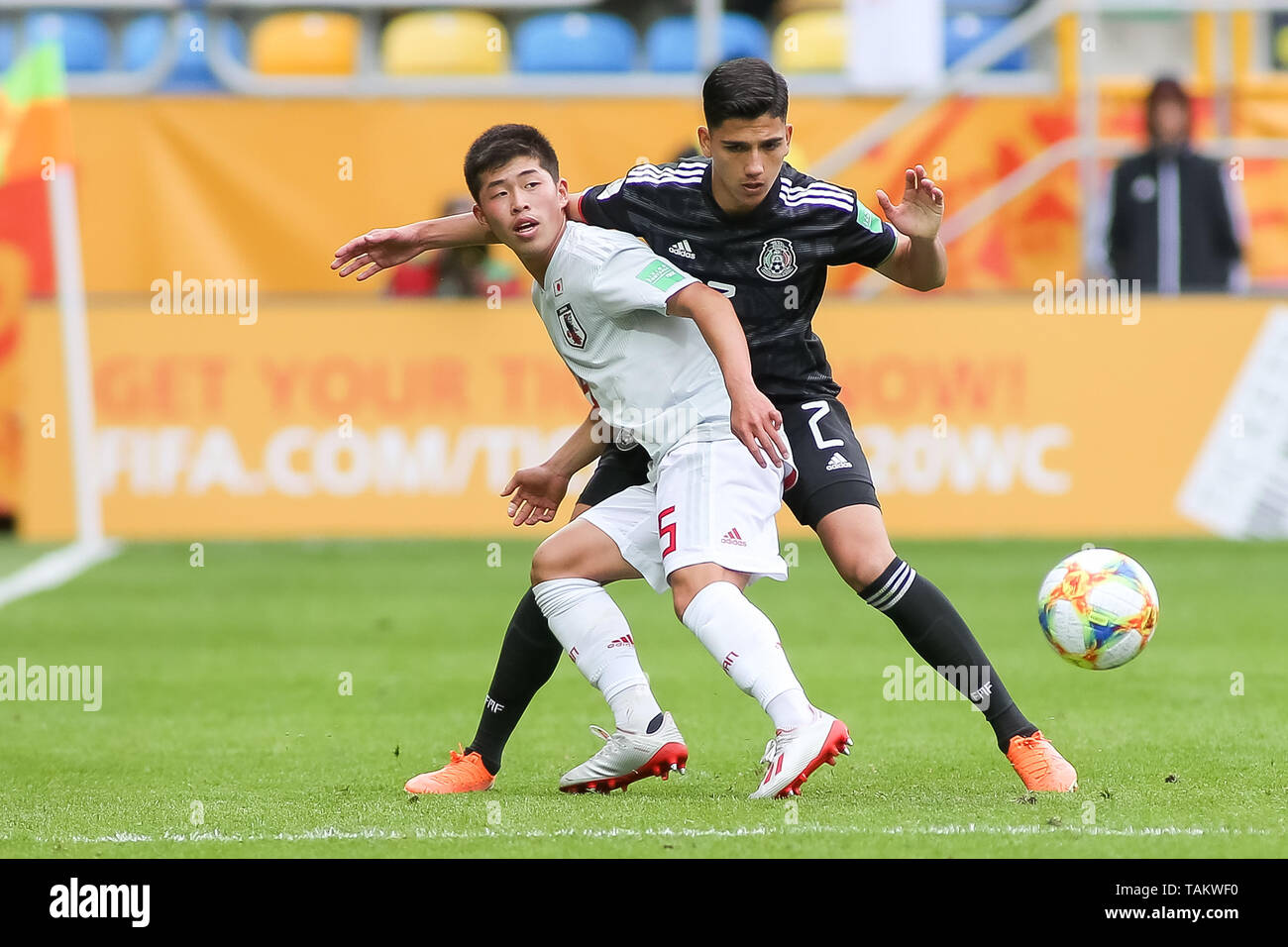 Gdynia Stadium, Gdynia, Poland - 26th May, 2019: Yukinari Sugawara (L) from Japan and Kevin Alvarez (R) from Mexico are seen in action during FIFA U-20 World Cup match between Mexico and Japan (GROUP B) in Gdynia. (Final score; Mexico 0:3 Japan) - Stock Image
