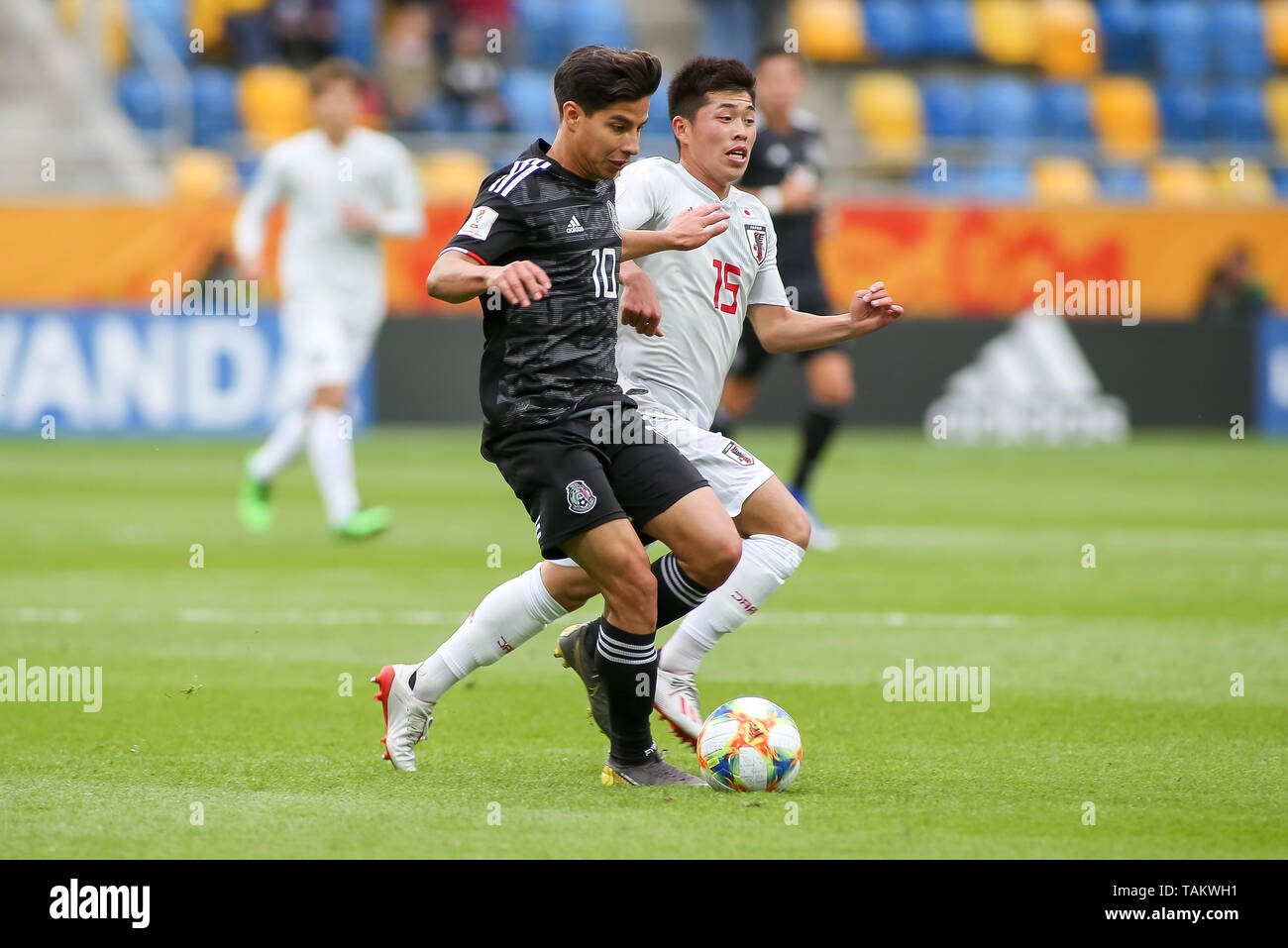 Gdynia Stadium, Gdynia, Poland - 26th May, 2019: Diego Lainez from Mexico and Toichi Suzuki from Japan are seen in action during FIFA U-20 World Cup match between Mexico and Japan (GROUP B) in Gdynia. (Final score; Mexico 0:3 Japan) - Stock Image