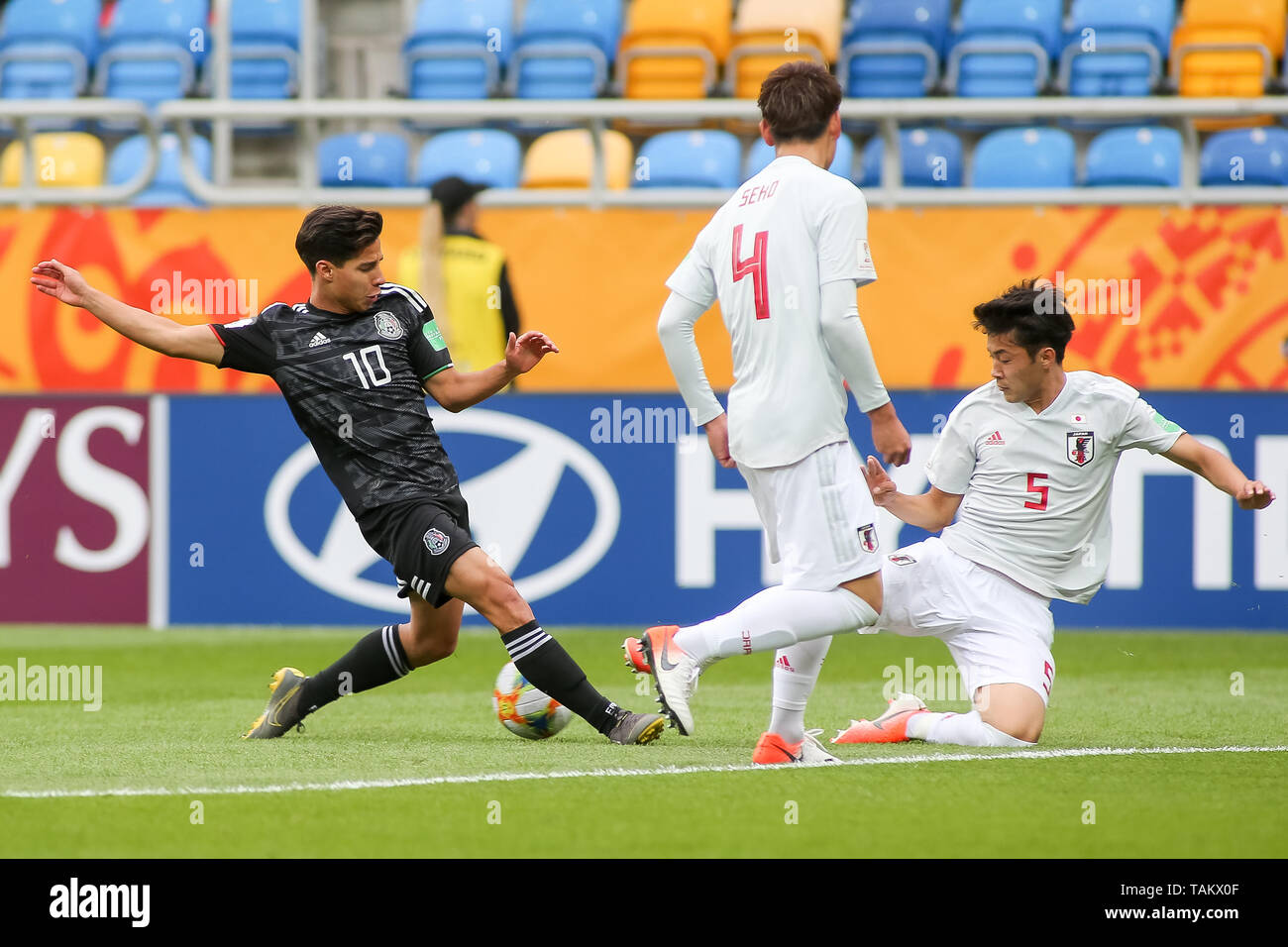 Gdynia Stadium, Gdynia, Poland - 26th May, 2019: Diego Lainez (L) from Mexico and Yukinari Sugawara (R), Ayumu Seko (C) from Japan seen in action during FIFA U-20 World Cup match between Mexico and Japan (GROUP B) in Gdynia. (Final score; Mexico 0:3 Japan) - Stock Image