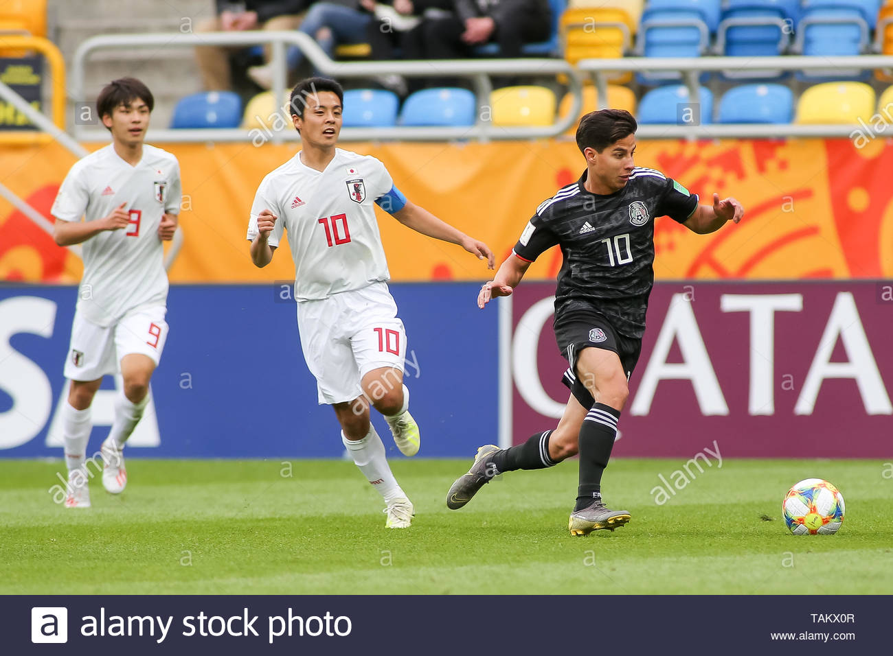 Gdynia Stadium, Gdynia, Poland - 26th May, 2019: Koki Saito (L), Mitsuki Saito (C) from Japan and Diego Lainez (R) from Mexico seen in action during FIFA U-20 World Cup match between Mexico and Japan (GROUP B) in Gdynia. (Final score; Mexico 0:3 Japan) - Stock Image