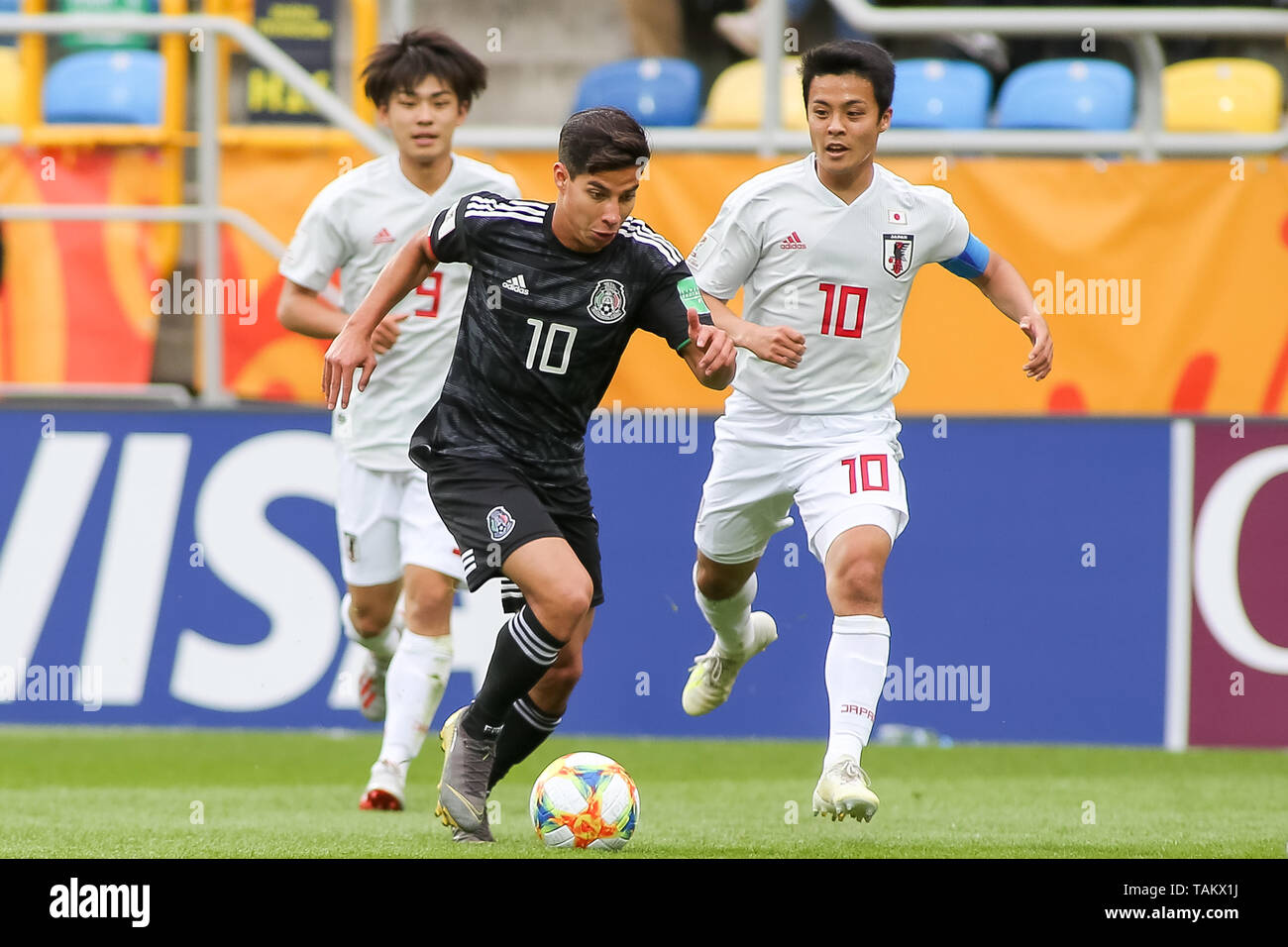 Gdynia Stadium, Gdynia, Poland - 26th May, 2019: Koki Saito (L), Mitsuki Saito (L) from Japan and Diego Lainez (C) from Mexico seen in action during FIFA U-20 World Cup match between Mexico and Japan (GROUP B) in Gdynia. (Final score; Mexico 0:3 Japan) - Stock Image