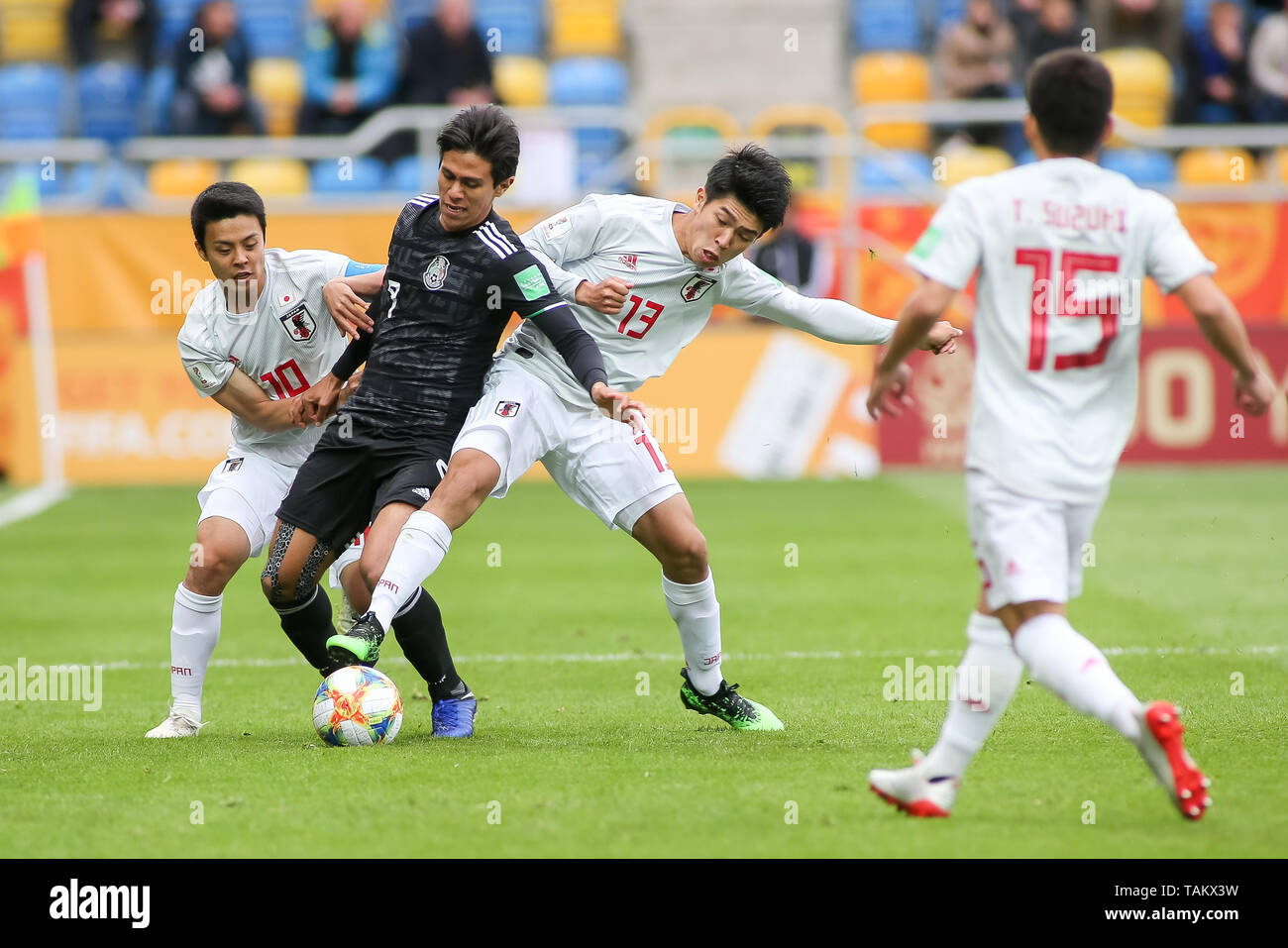 Gdynia Stadium, Gdynia, Poland - 26th May, 2019: Mitsuki Saito (L), Taisei Miyashiro (R) from Japan and Jose Macias (C) from Mexico seen in action during FIFA U-20 World Cup match between Mexico and Japan (GROUP B) in Gdynia. (Final score; Mexico 0:3 Japan) - Stock Image