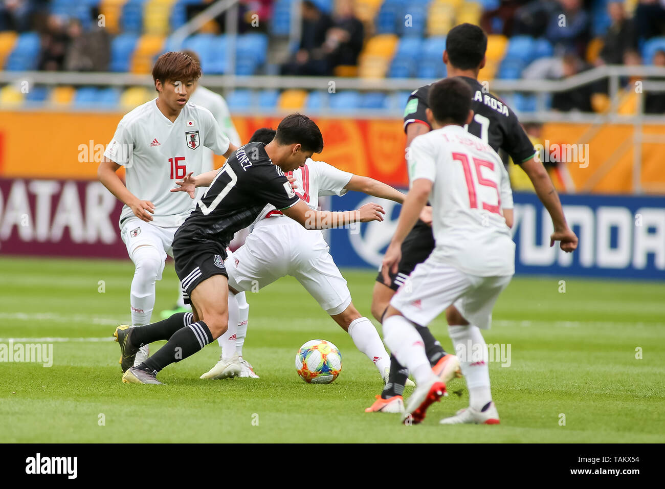 Gdynia Stadium, Gdynia, Poland - 26th May, 2019: Kota Yamada(L) from Japan and Diego Lainez (CL) from Mexico seen in action during FIFA U-20 World Cup match between Mexico and Japan (GROUP B) in Gdynia. (Final score; Mexico 0:3 Japan) - Stock Image
