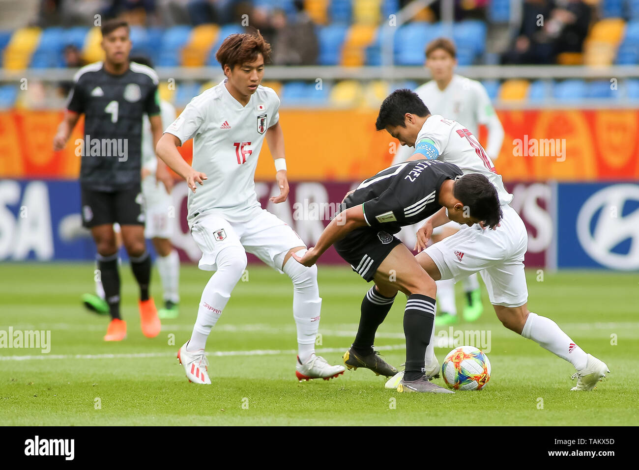 Gdynia Stadium, Gdynia, Poland - 26th May, 2019: Kota Yamada(L), Mitsuki Saito (R) from Japan and Diego Lainez(C) from Mexico seen in action during FIFA U-20 World Cup match between Mexico and Japan (GROUP B) in Gdynia. (Final score; Mexico 0:3 Japan) - Stock Image