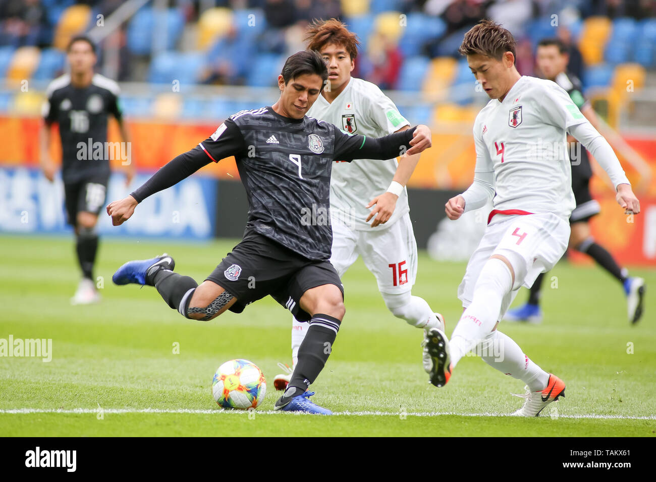 Gdynia Stadium, Gdynia, Poland - 26th May, 2019: Jose Macias (L) from Mexico and Kota Yamada (C), Ayumu Seko(R) from Japan seen in action during FIFA U-20 World Cup match between Mexico and Japan (GROUP B) in Gdynia. (Final score; Mexico 0:3 Japan) - Stock Image