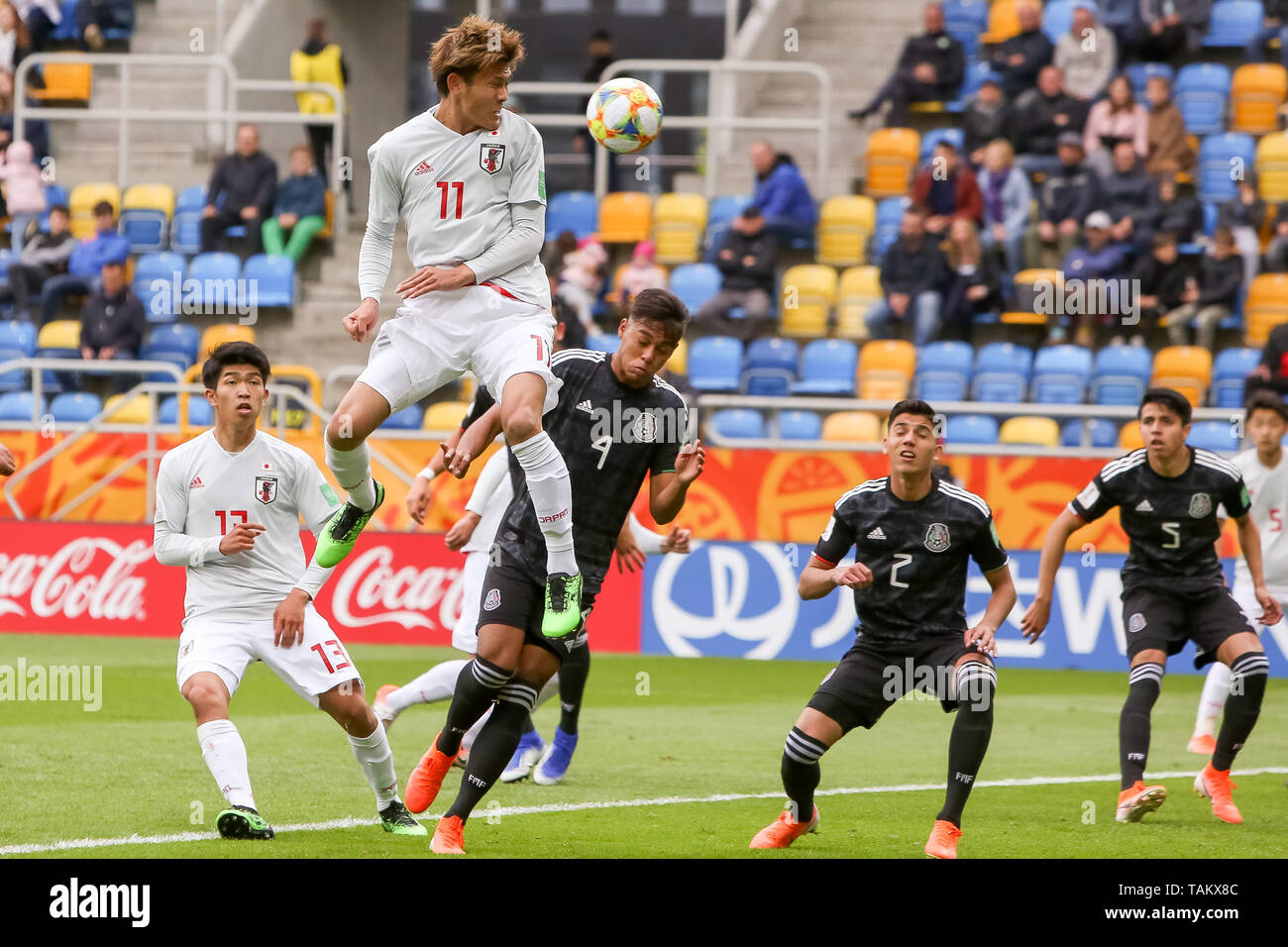 Gdynia Stadium, Gdynia, Poland - 26th May, 2019: Taisei Miyashiro, Kyosuke Tagawa from Japan and Efrain Orona, Kevin Alvarez, Naelson Cardenas from Mexico are seen in action during FIFA U-20 World Cup match between Mexico and Japan (GROUP B) in Gdynia. (Final score; Mexico 0:3 Japan) - Stock Image