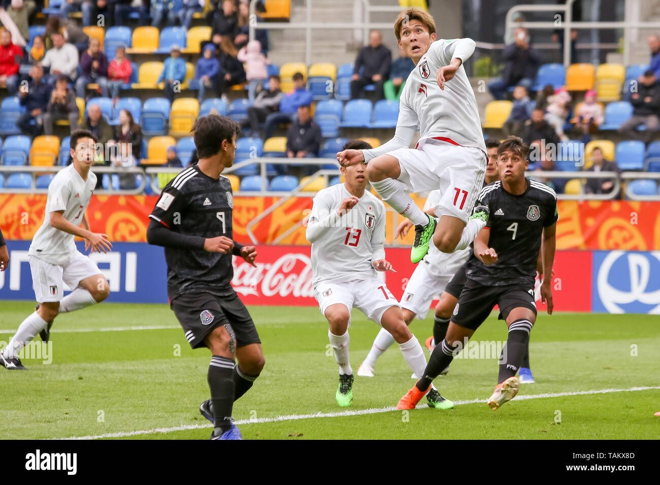 Gdynia Stadium, Gdynia, Poland - 26th May, 2019: Kyosuke Tagawa from Japan and Efrain Orona, Jose Macias from Mexico are seen in action during FIFA U-20 World Cup match between Mexico and Japan (GROUP B) in Gdynia. (Final score; Mexico 0:3 Japan) - Stock Image