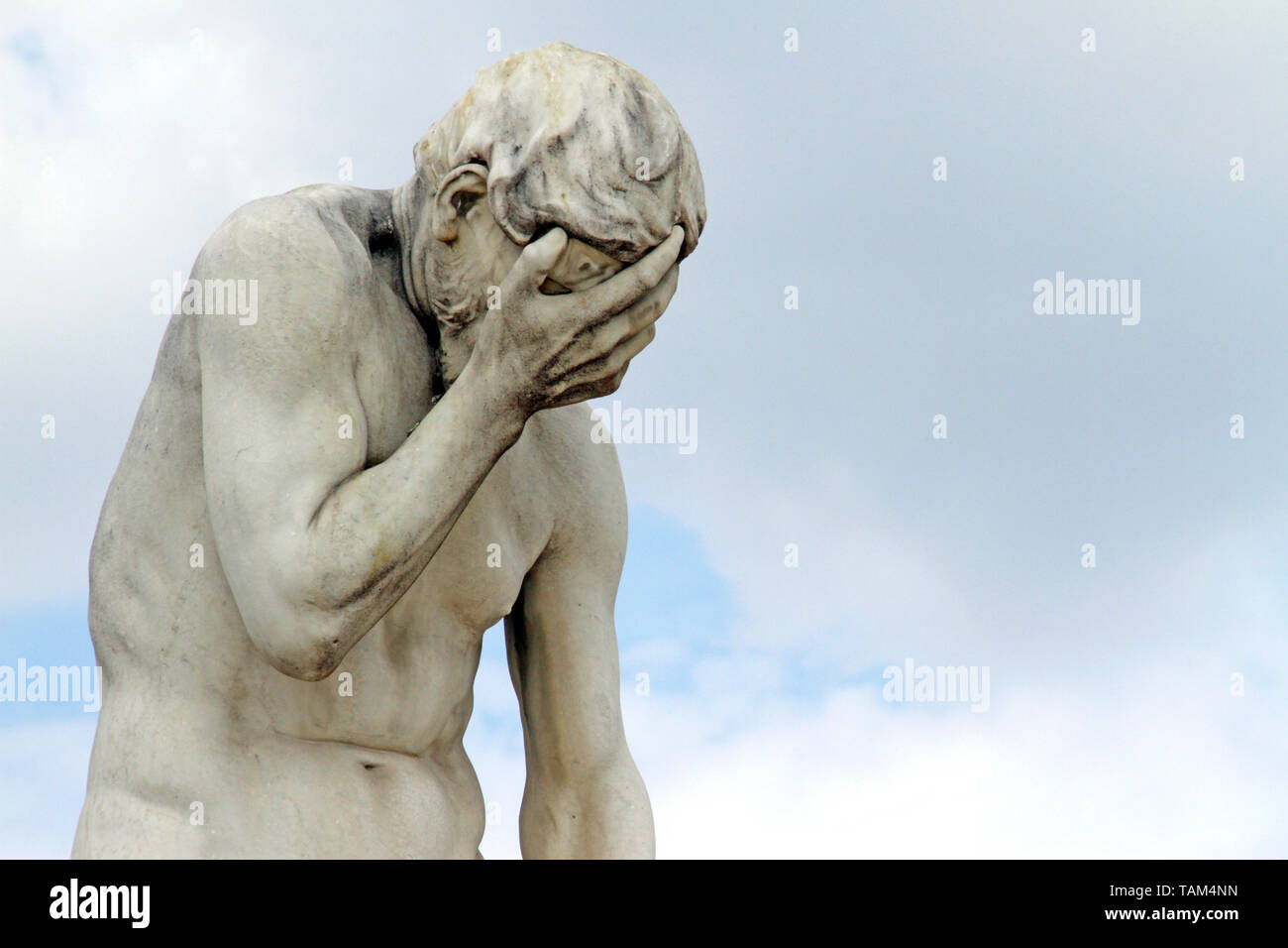 Facepalm - ashamed, sad, depressed. Statue with head in hand - Stock Image