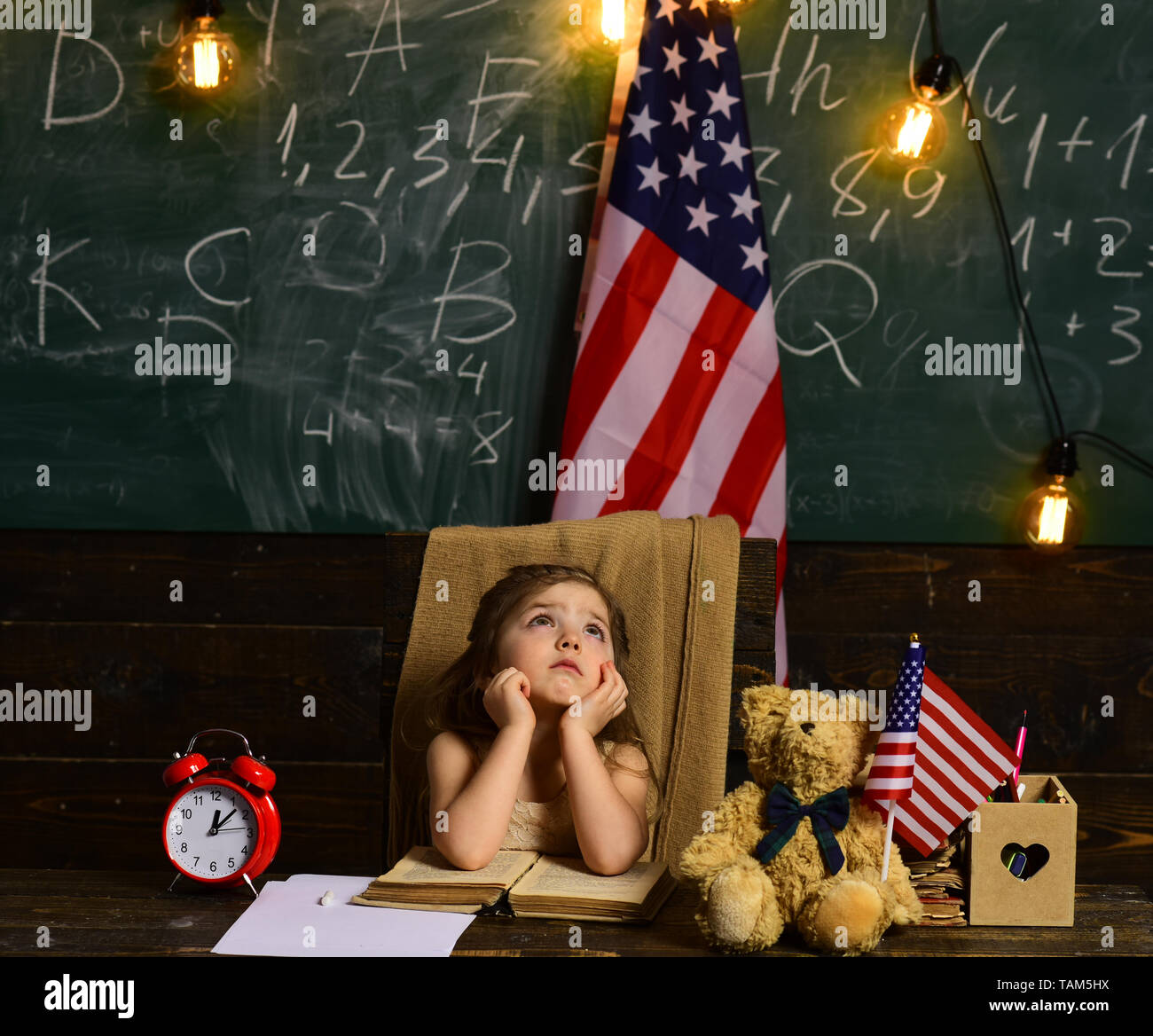 Tutor he must also have the parents trust. US flag and a blackboard. Little help can get student back on track. Education university and school system - Stock Image