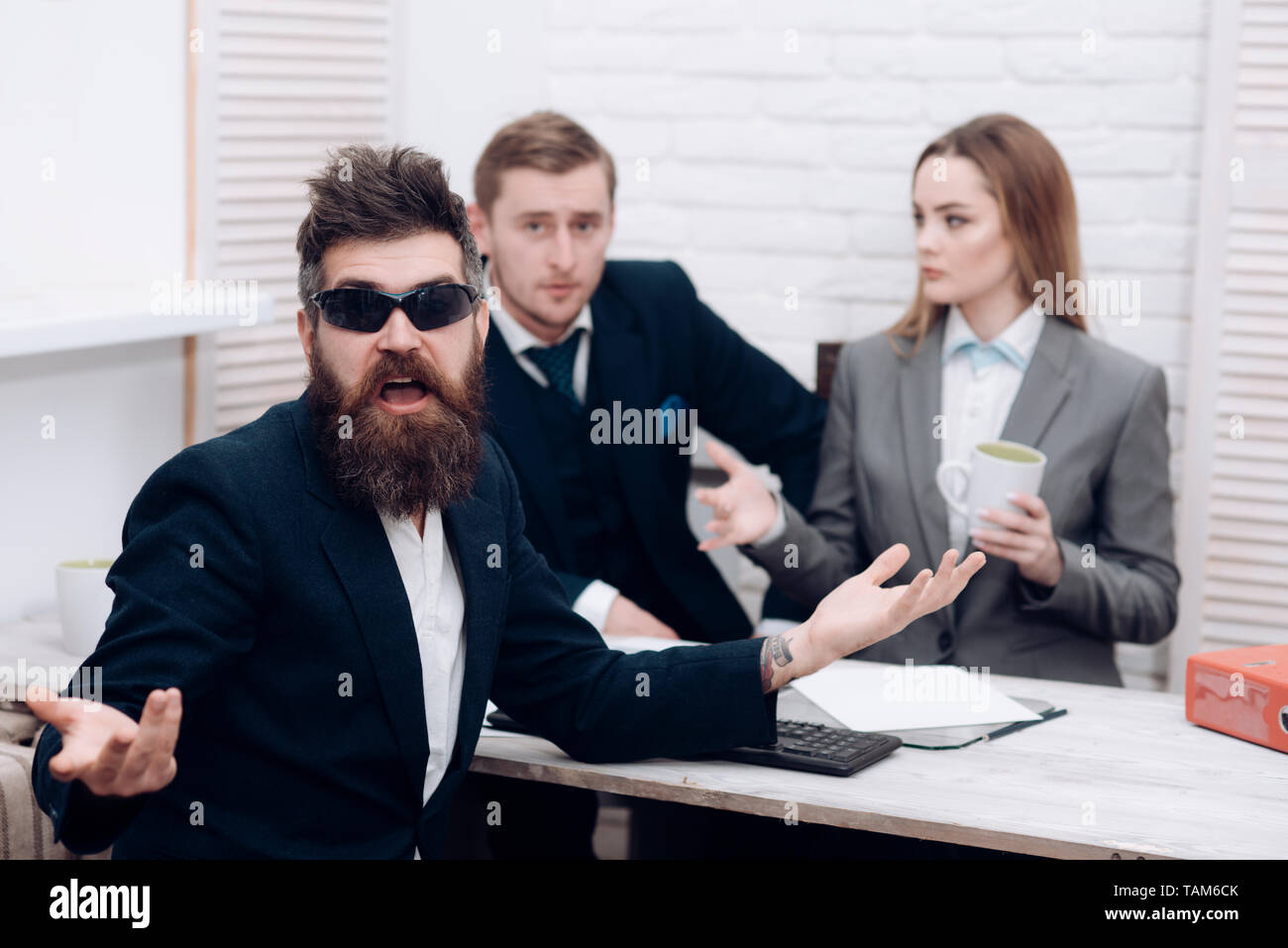 Business partners or businessman at meeting, office background. Startup concept. Man with beard and glasses proposes extraordinary startup idea - Stock Image