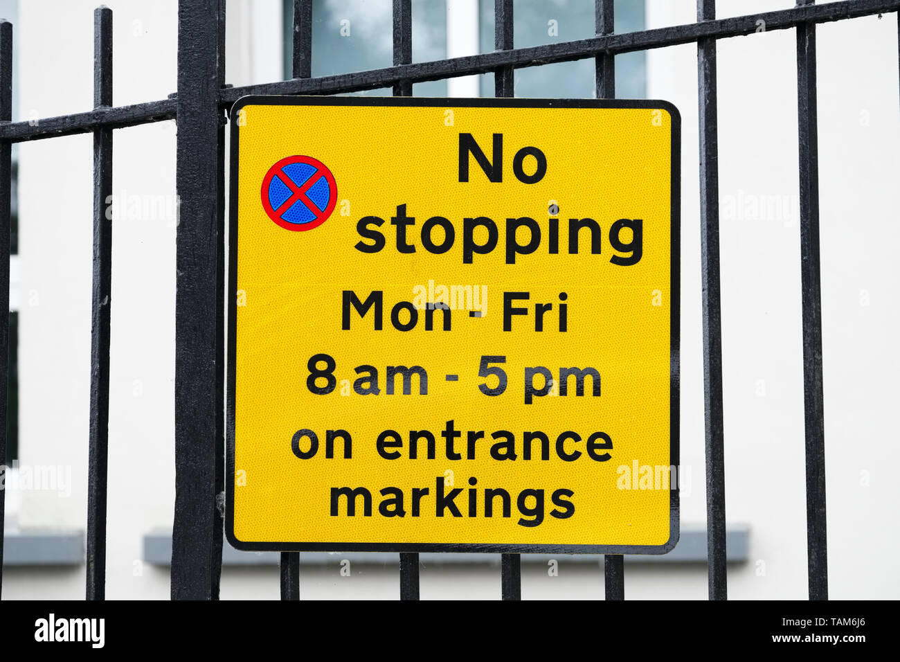 No stopping Monday to Friday on entrance school markings - Stock Image