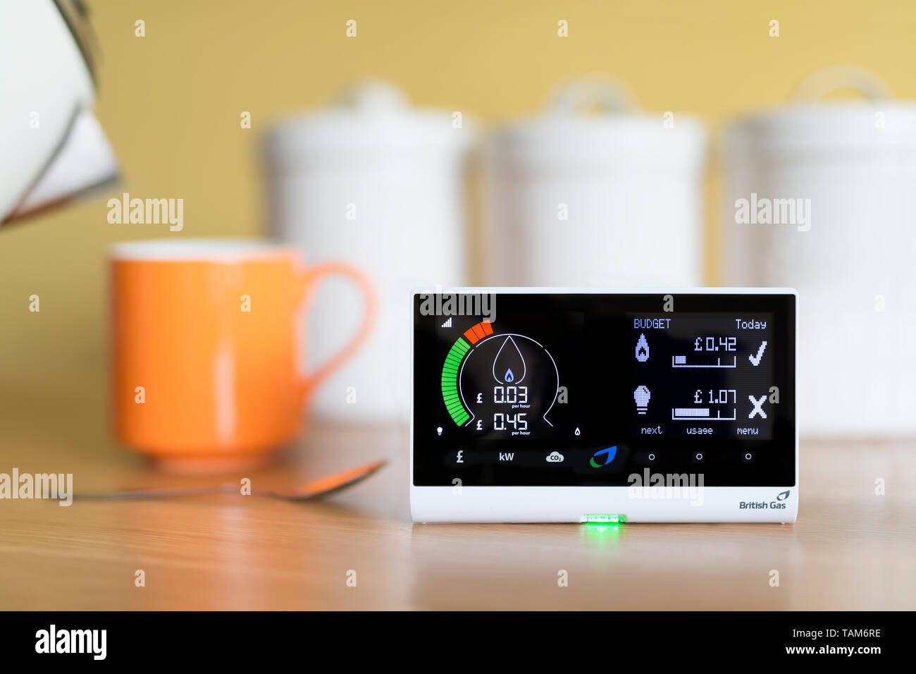 A domestic use British Gas energy smart meter displaying the cost of gas electricity usage in a UK home, placed in a kitchen environment. - Stock Image