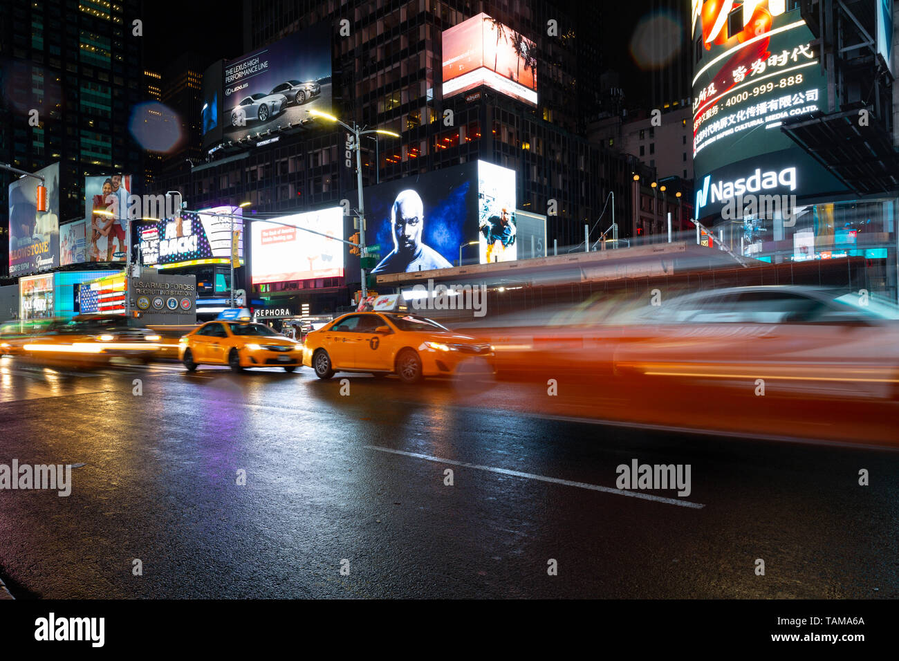 Long exposure of taxis in Times Square at night - New York, NY Stock Photo