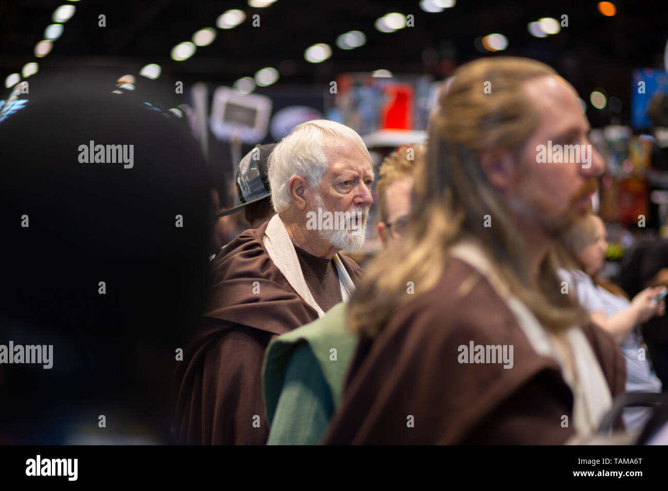 Men dressed in costume as Obi-Wan Kenobi and Qui-Gon Jinn at Star Wars Celebration 2019 - Chicago, IL - Stock Image