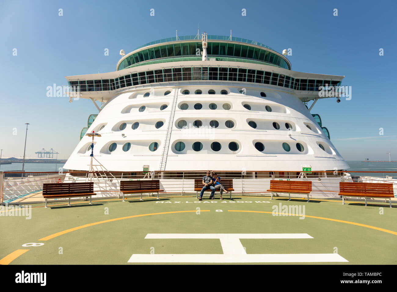 Independence of the Seas Cruise Ship; Zeebrugge, Belgium; 24th May 2019; View of Ship From Bow With Couple Seated on a Bench in Bright Sunny Weather - Stock Image