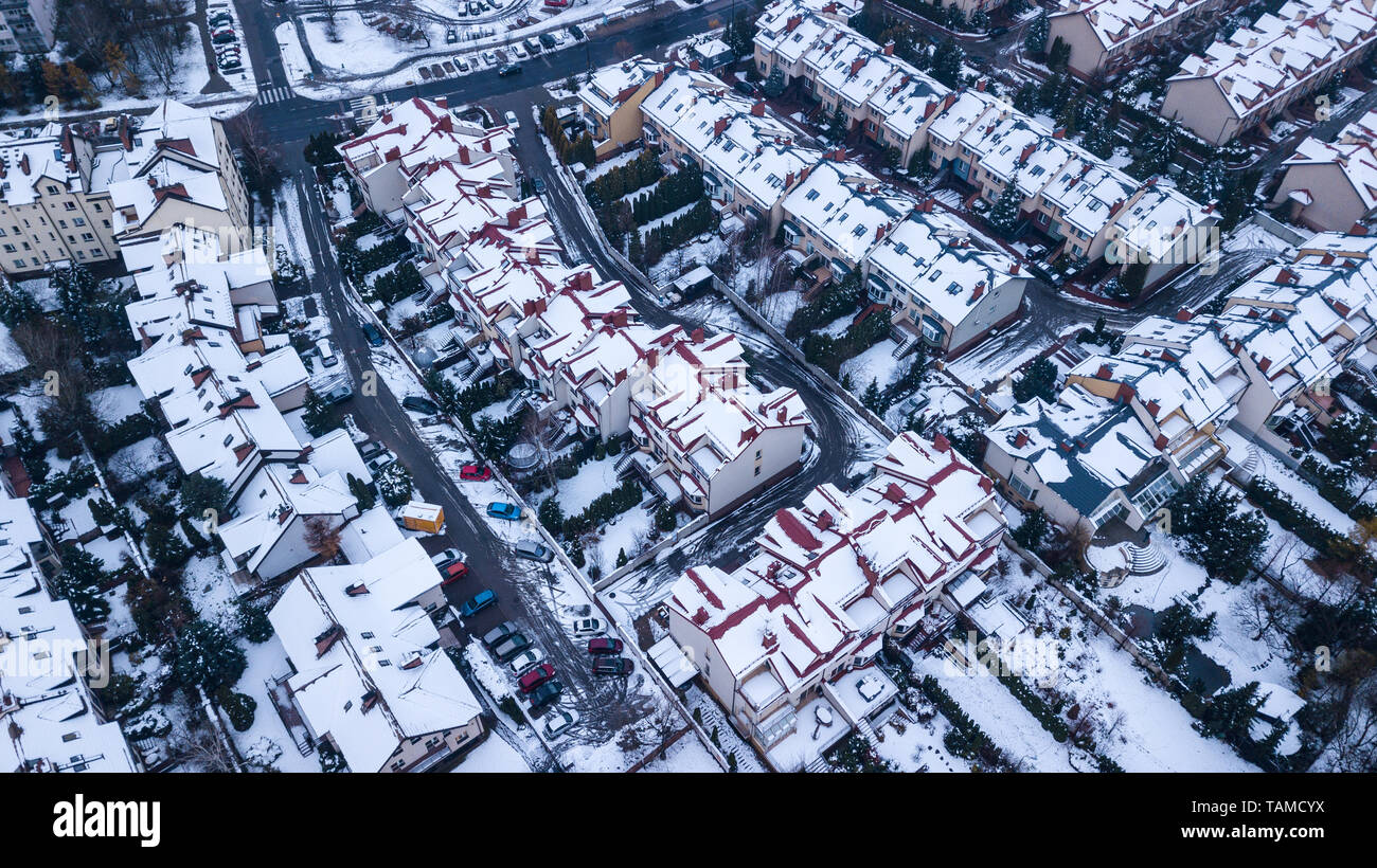 Aerial view of snowed in traditional housing suburbs - Stock Image