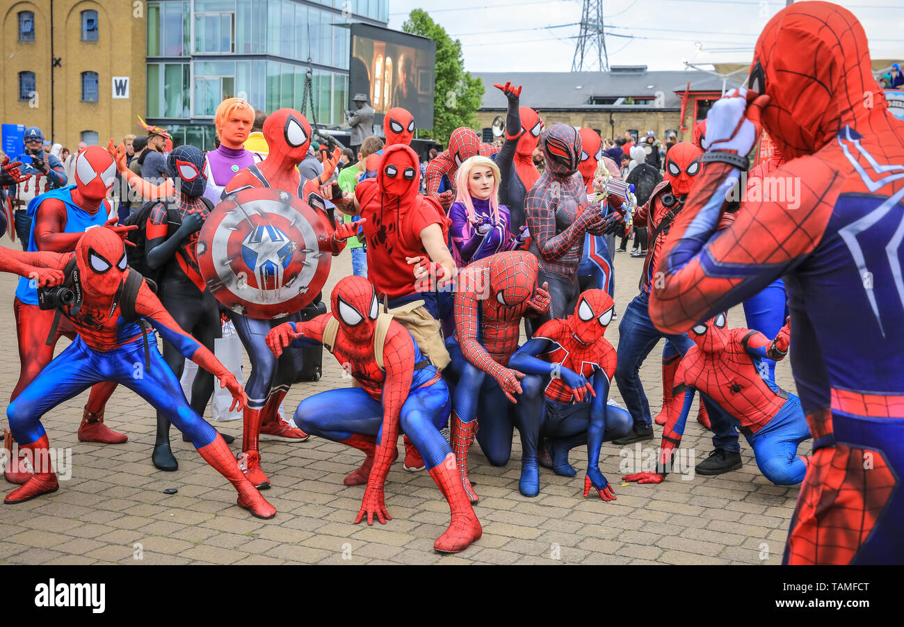 london-uk-26th-may-2019-when-one-spiderman-tries-to-direct-a-lot-of-other-spidermen-for-a-group-spider-picture-things-start-to-go-a-bitchaotic-a-friendly-group-of-over-thirty-spidermen-and-spiderwomen-from-a-social-media-group-called-spider-verse-pose-up-a-storm-and-have-fun-at-the-event-mcm-comicons-third-and-final-day-once-again-sees-thousands-of-cosplayers-and-fans-of-comics-games-and-sci-fi-and-fantasy-turn-up-in-fantastic-costumes-and-outfits-at-excel-london-to-celebrate-their-favourite-characters-credit-imageplotteralamy-live-news-TAMFCT.jpg