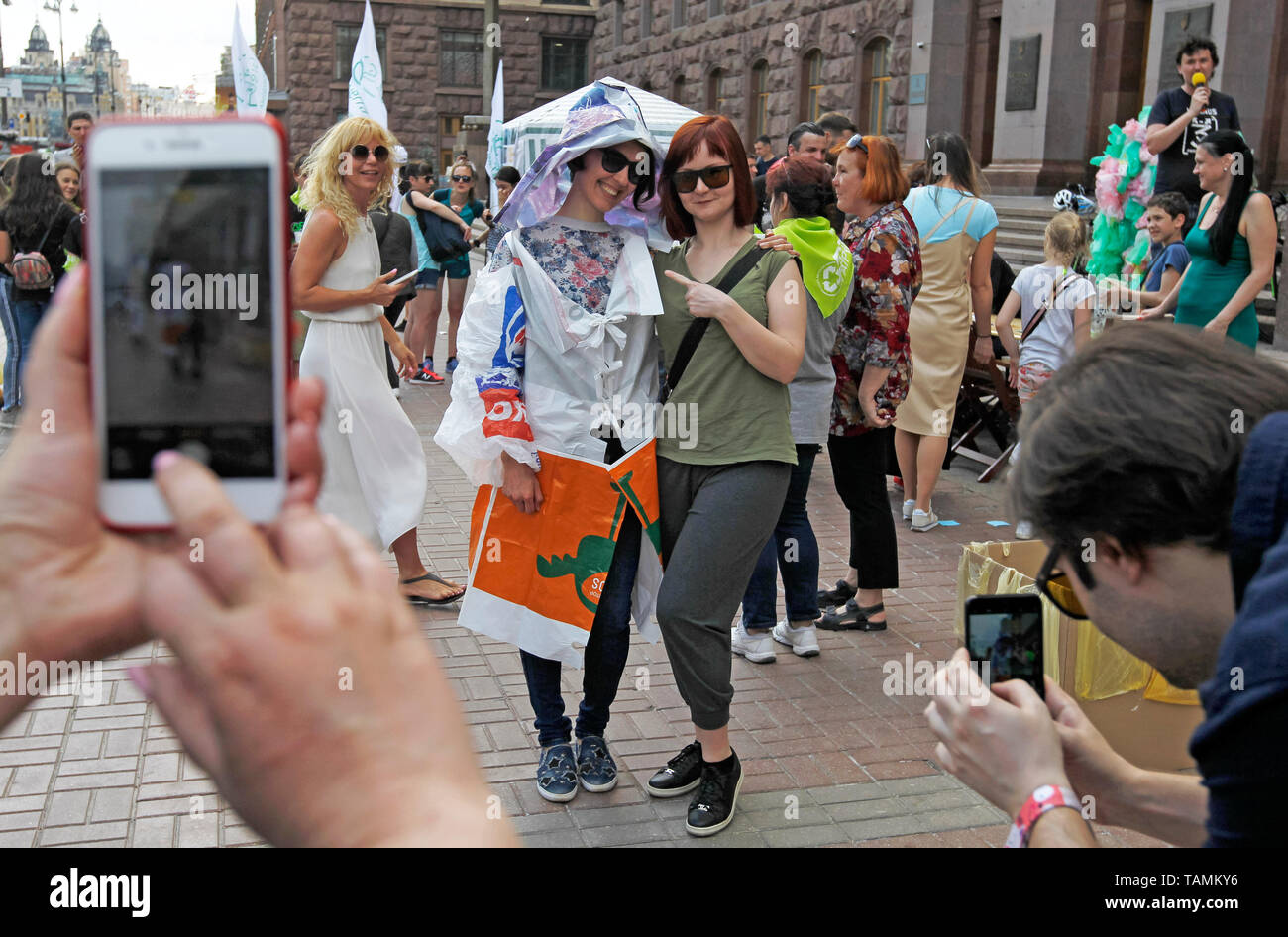 Kiev, Ukraine. 26th May, 2019. An eco activist is seen dressed in plastic bags posing for a photo during the protest. A group of environmental activists organized a 'March of plastic bags' outside the Kiev City Hall in Kiev, Ukraine. The activists want a solution to the problem of using and processing of polyethylene bags and other plastic packaging. They called for restrictions on the use of plastic bags. Credit: SOPA Images Limited/Alamy Live News - Stock Image