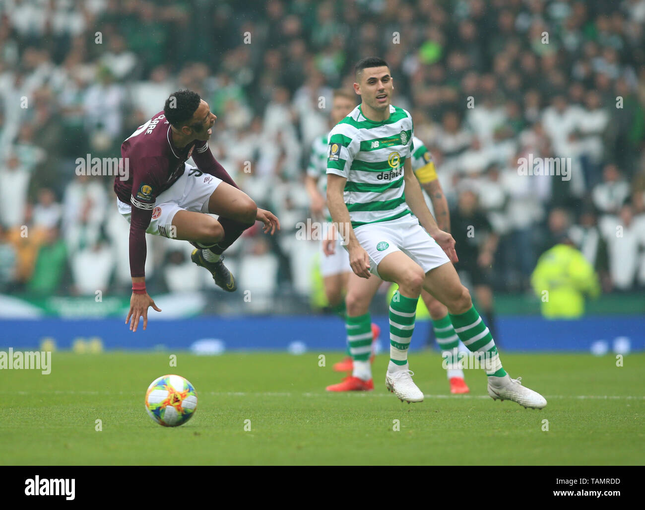 25th May 2019, Hampden Park, Glasgow, Scotland; Scottish Football Cup Final, Heart of Midlothian versus Celtic; Tom Rogic of Celtic tackles Sean Clare of Heart of Midlothian - Stock Image