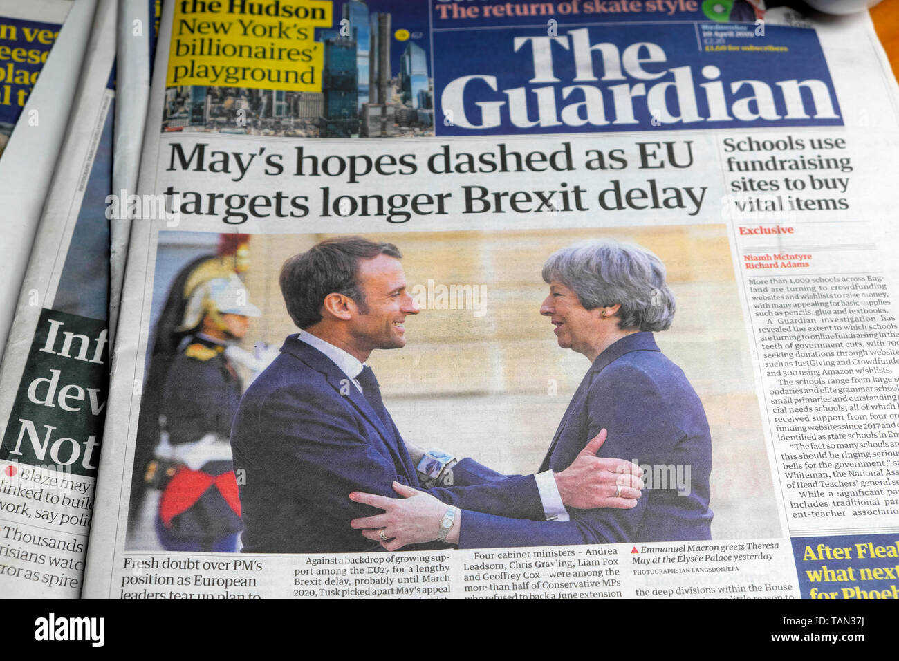 'May's hopes dashed as EU targets longer Brexit delay' in The Guardian front page newspaper headline as French President Emmanuel Macron greets Tory PM Theresa May in Paris France Europe EU on 9 April 2019 - Stock Image