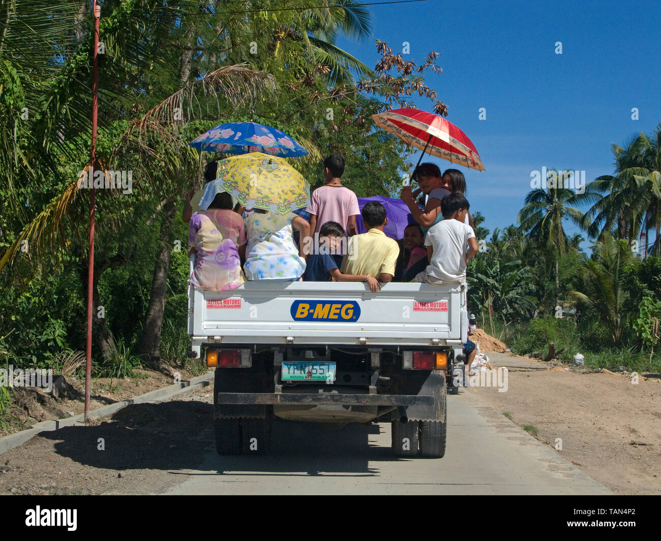 Locals on a truck, common public transportation in the Philippines, Moalboal, Cebu, Visayas, Philippines - Stock Image