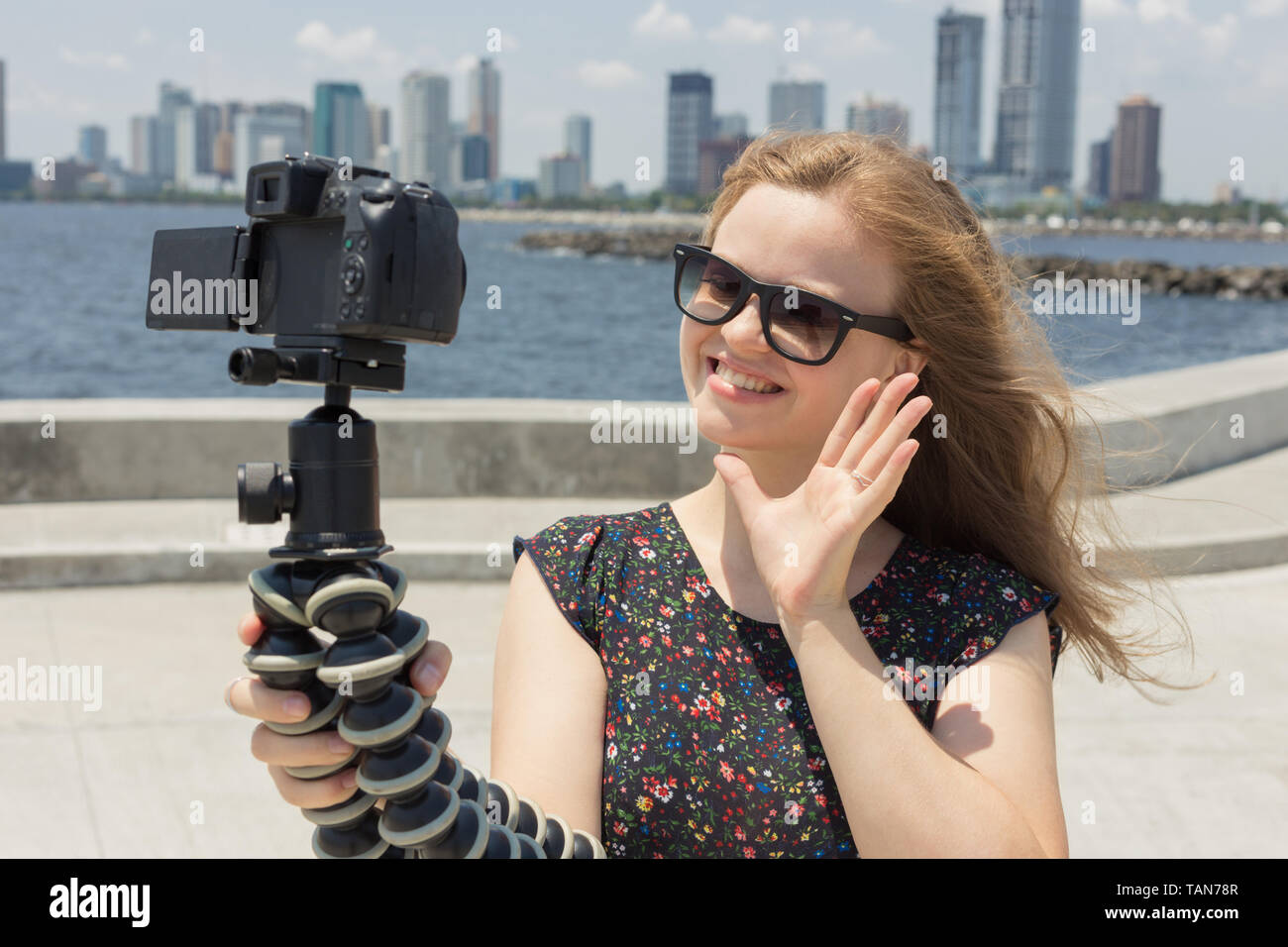 Camera recording a young caucasian woman blogger making a video or selfie Stock Photo