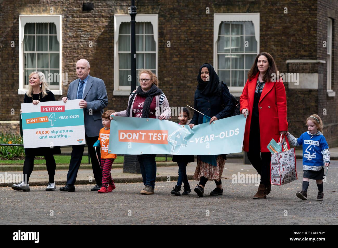 Pre-schoolers Safa Patel (centre), Alex Harrison (orange top) and Isla Tart (blue top) with their parents and Tracy Brabin MP (left) (Shadow Minister for Early Years) and Jack Dromey (2L) (Shadow Minister for Pensions) deliver a 65,000 signature petition to 10 Downing Street calling for a halt to plans to test four-year-olds when they start school.  The protest has been organised by More Than A Score, the alliance  of parents, teachers, heads and education experts, working together to call for change to the government's policy on standardised testing.  They point out that, from 2020, pupils wi - Stock Image