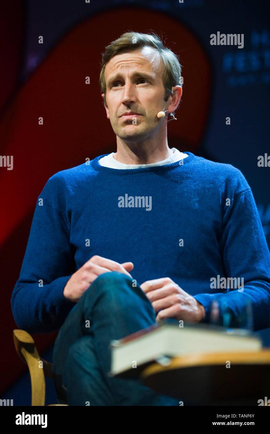Robert Macfarlane British travel writer speaking on stage at Hay Festival Hay-on-Wye Powys Wales UK - Stock Image