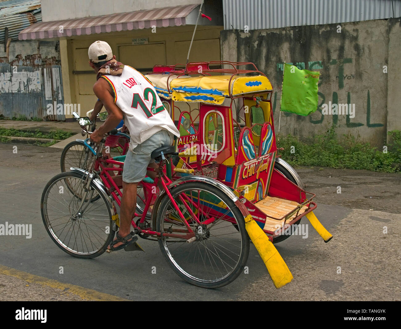 Filipino with traditional Tricycle, common public transportation, Moalboal, Cebu, Central Visayas, Philippines - Stock Image