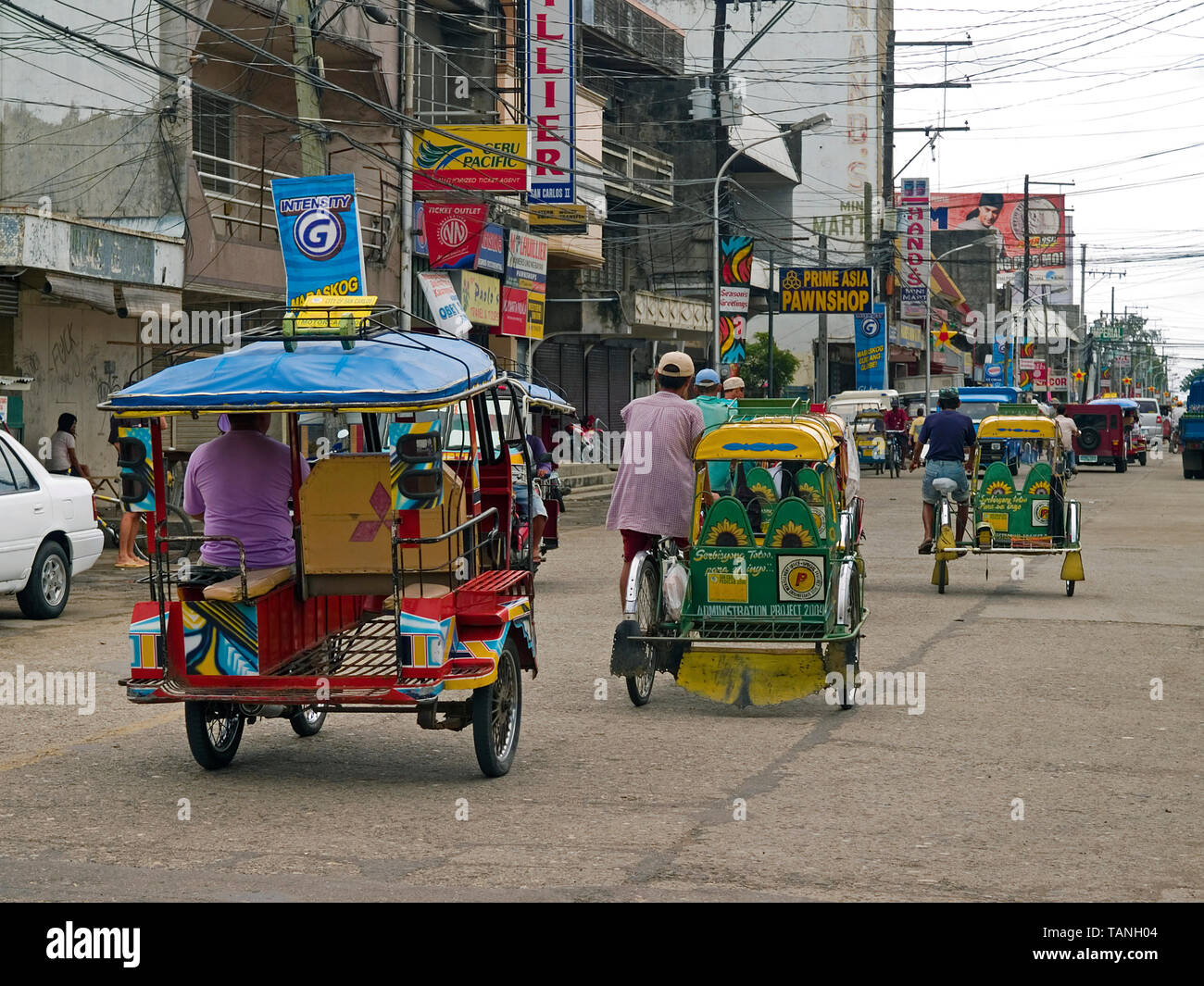 Filipinos with traditional Tricycles, common public transportation, Moalboal, Cebu, Central Visayas, Philippines - Stock Image