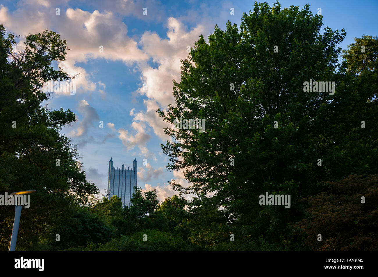 One PPG Place, corporate headquarters of PPG Industries and co-headquarters of Kraft Heinz, Pittsburgh, Pennsylvania seen at sunrise from Point State  - Stock Image